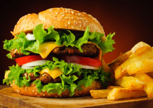 closeup of traditional cheeseburger or hamburger and frech fries